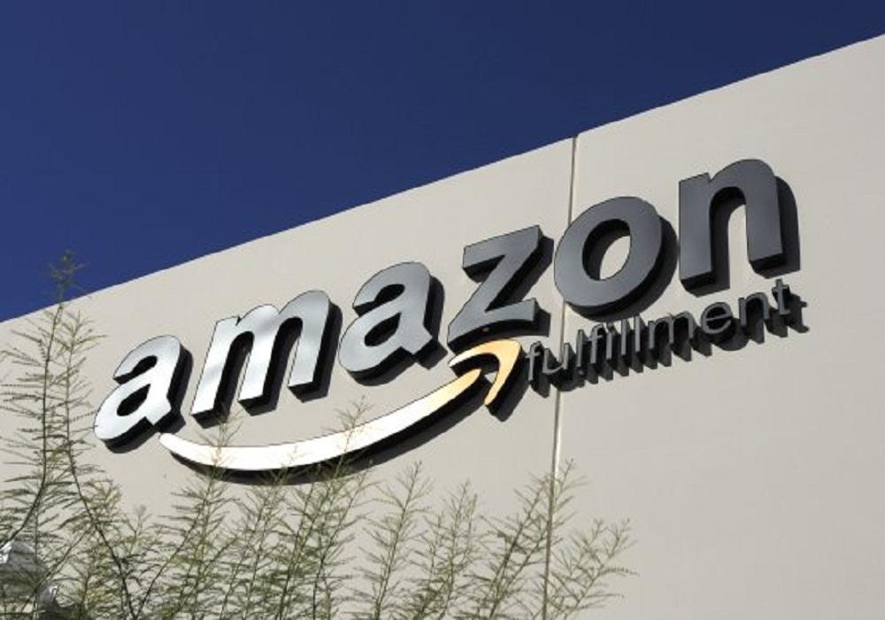 Amazon CEO Jeff Bezos pilots giant robot