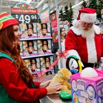 """Brick-and-mortar retailers are stooping to selfie booths and """"holiday helpers"""" to fend off Amazon"""